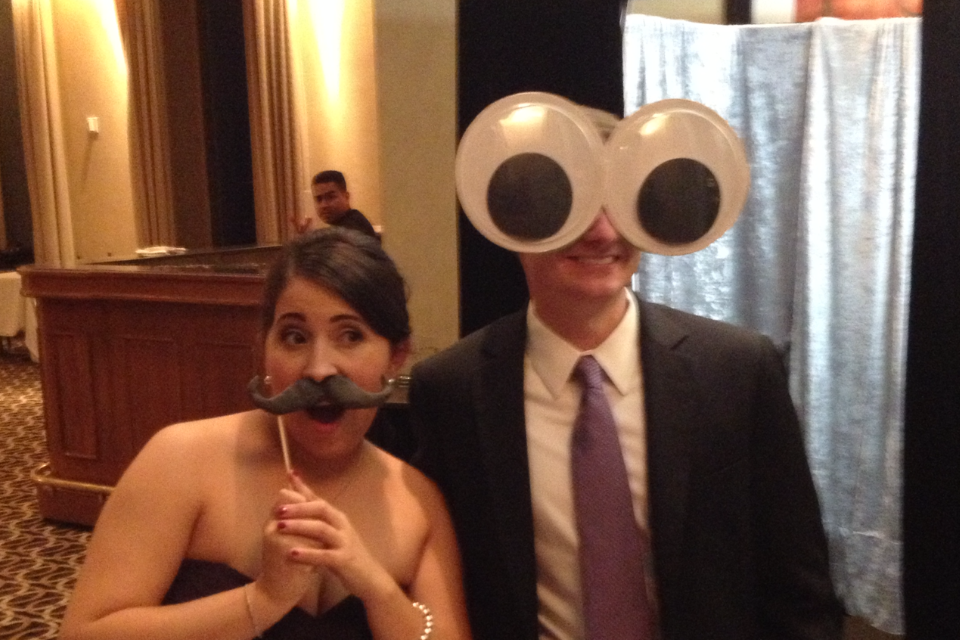 Man has huge googely eyes and his date has a mustache