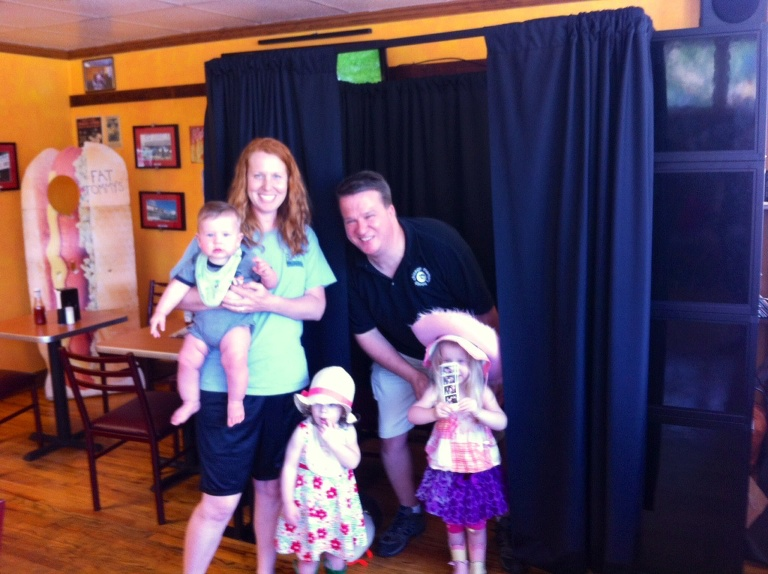 family of 5 enjoying a photo booth rental chicago