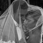 Brides veil swept over both of them