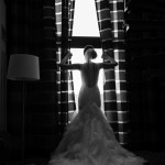 bride in her dress getting ready for the big day looking away from the photographer